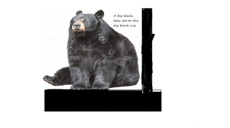"""Czarny niedźwiedź siedzi na czarnym podłożu obok czarnego pnia. Obok niedźwiedzia napis: """"A big black bear sat on the big black rug."""""""